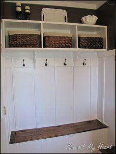 kind of the right idea but more contemporary hooks and in 2 rows for kids hanging and shoe holes under bench seat