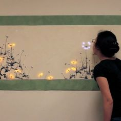 Blowing on interactive dandelion art makes seeds disperse and grow (Wired UK) Interactive Exhibition, Interactive Walls, Interactive Media, Exhibition Display, Interaktives Museum, Interaktives Design, Dandelion Painting, Verre Design, Projection Mapping
