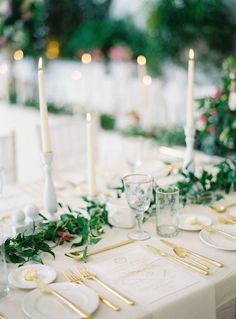 Tall Tapered Candles: Want to pull off the ultimate winter wedding? A good variety of greenery, candlelight and gold details against a snowy white tablescape is all it takes. (via Peaches and Mint) **Would add more greenery and more gold mercury votives! As well as some flowers