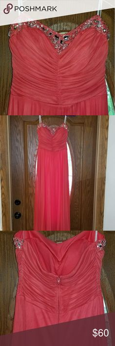 Junior's prom dress Salmon junior's prom dress. Bodice has silver rhinestones with a sweetheart top. Dresses Prom