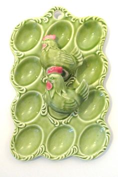 Vintage devilled egg plate with salt & pepper shakers in the shape of roosters (or chickens?). The egg plate is a beautiful, springy shade of green, with many indentations to safely hold your decorated Easter eggs or halved eggs.
