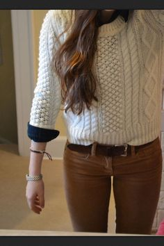 tan pants and navy blue and chunky sweater (:
