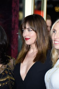 Dakota Johnson Photos Photos - Actress Dakota Johnson (L) and director Sam Taylor-Johnson attends the 'Fifty Shades of Grey' premiere during the 65th Berlinale International Film Festival at Zoo Palast on February 11, 2015 in Berlin, Germany. - 'Fifty Shades of Grey' Premiere - 65th Berlinale International Film Festival