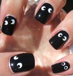 "Googly Eye nail polish!  I painted these this week. It was harder than I thought to paint perfect little circles, especially with my ""wrong"" hand. LOL!"