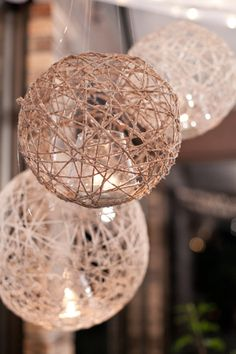 Twine lanterns, huh.   http://www.etsy.com/listing/90560617/custom-made-string-lanterns-in-natural?ref=sc_1&sref=
