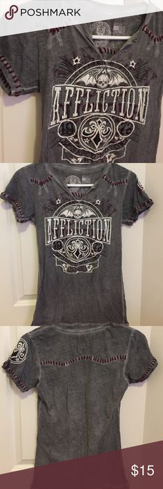 Affliction tee dark gray & red Awesome affliction tee. Love the thick red stitching accents. Has black sequins in front & has v neck. Love this tee but sadly doesn't fit anymore. It's in great condition only worn handful of times & taken care of. Affliction Tops Tees - Short Sleeve