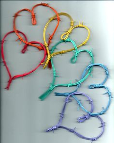 hearts made from barbed wire and painted