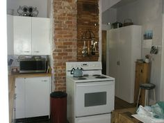 expose the brick chimney in the kitchen