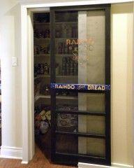 Old sliding screen door as a pantry door.  Great great idea
