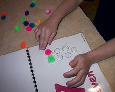 childcareland.com - downloadable pom pom counting book template