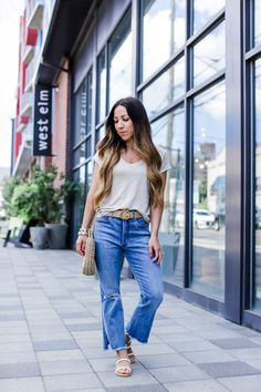 Let's talk flare jeans. Not usually a fan of them being petite but they are a big time trend right now. I call these the mini flare. Not overkill but still on trend. Styled with a linen v-neck tee, straw belt & bag. Fresh put together and ready to take on your day. For more inspiring fashion visit my Express post for June at houseofleoblog.com don't forget to use my coupon code. #flarejeans#denim#strawbelt#strawbag#slides#tee#linentee#casualoutfit#summer#express#trendy#houseofleoblog
