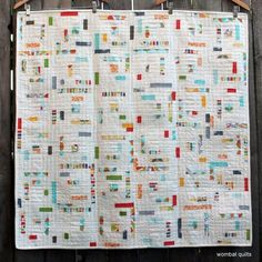 ichael Miller challenge quilt (made using 1 inch strips mixed with much white background fabric and made in log cabin style) | Wombat Quilts