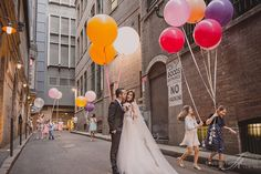 Photography by Studio Impressions. Colourful cheerful balloons set in an urban setting. Fun. Current. On trend.