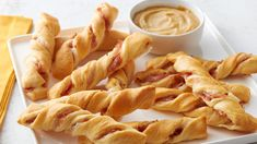 Need a last-minute party app? You are just three ingredients away from these easy twists. Serve them with honey mustard or jam!