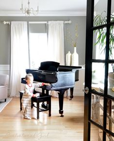 """Never off limits as long as it is treated gently""  Love this.  black baby grand piano living room"