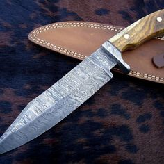 Overall Length: 11.5 inches Handle Material: Handle made of NATURAL WOOD AND DAMASCUS STEEL GUARD Blade Thickness: 5 mm Approx Blade Hardness: 56-60 HRC THE BLADE THIS IS A BRAND NEW KNIFE. THIS KNIFE DAMASCUS STEEL s
