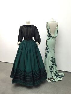 Jacques Fath black organdy evening blouse and green faille skirt with black satin ribbon appliqué, Fall/Winter 1951, and John Galliano's pale green crepe dress with re-embroidered cherries on a print by Luiven Rivas-Sanchez.