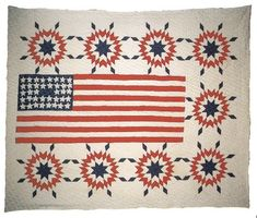 "Patriotic Quilt        c. 1920's  Colorado  67 1/2"" X 83""  Cotton. Pieced, appliquéd and quilted. The exploding stars which surround the 38 star flag suggest Fourth of July firecrackers. This masterpiece was probably made in 1926 to celebrate Colorado's 50th anniversary of statehood. Colorado was the 38th state to enter the Union. From the collection of Marcia and Ron Spark"