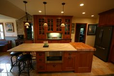 Open Concept Kitchen, Large Kitchen Island, Breakfast Nook, Large tile floor, china hutch, bead board ceiling, Copper farmers sink, peninsula island seating, warming drawer, butcher block,