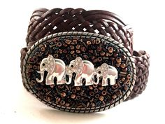 "Oval silver buckle covered with brown toned beads and 3 silver elephants Leather snap belt included Buckle Measurements: 3 1/4"" x 2 3/4"""