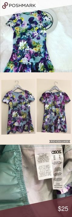 """ASOS Full Bloom Ruffle Hem ASOS petite purple floral mini dress. GUC with a few small white dots as pictured. Not that noticeable since the pattern is so bold. Measures 28.5"""" long and 17"""" pit to pit. USA 6 UK10. Hidden zip back closure. Ruffle hem. My 1st photo is filtered. Last 3 photos are taken in natural light. Color may vary depending on your device's  screen. ASOS Petite Dresses Mini"""