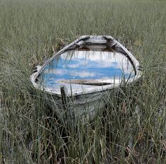 white boat mirror: White boat carrying white blue water / to the sea of my imagination. / Where the vessel drifts ashore / another journey begins - within./ Being somewhere, without longing - / reflecting colors that pass by.