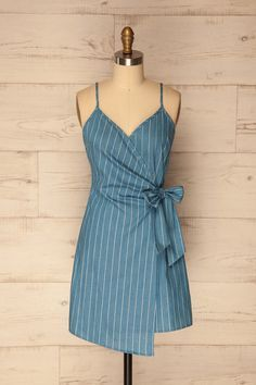 Tavigny #boutique1861 / Summer is fantastic for little dress fanatics! This one will enchant you with its classic stripes and wrap style that knots at the waist with an adorable bow. The thin straps are adjustable for a tailored fit. With platform sandals and a love of the outdoors, your next picnic will be an event full of style!