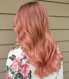 Switch up your fall hair color with this rose gold hue.