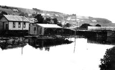 "The Brighton Bridge about 1898. The boatsheds are now there, as is the church that was to become the shop. ""Prospect Gap"" has been blasted through at Big Rock and there are many houses and cribs."