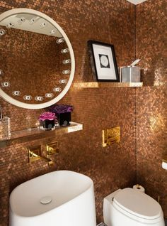 Do you have a piggy bank bursting at the seams? Take the penny tile trend literally like the residents of this Redpath apartment in Montreal did, and cover your walls with actual pennies.