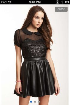 Black dress with a sparkly bust area and capped sleeves