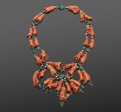 Carved Coral and Emerald Bead Wilting Hibiscus Necklace by Suzanne Belperron, circa 1930s