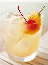 Dress up your cocktails with a fruit skewer. Try a maraschino cherry and an orange slice in this bourbon and citrus juice combination.