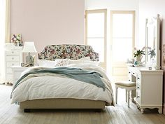 Floral bedhead, pretty flowers, pastel colours = Shabby Chic bedroom. #Romantic #Pretty #Yesplease