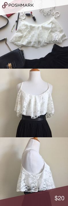 Tobi White Lace Crop Top Tobi White Lace Flared Crop Top. Size L. Inner white bandeau with elastic hem covered by outer white lace. 100% Polyester. Gently worn. No rips, holes, or stains. Tobi Tops Crop Tops