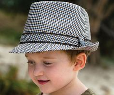 Boys Andy Fedora. It doesn't get more stylish than this. The Andy Fedora is made from 100% cotton brown plaid with very smart stitching and detail.