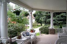 I totally want a wrap around porch!!!!