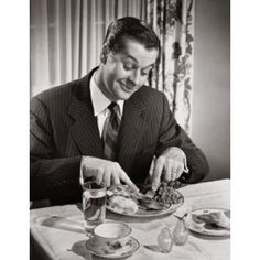 High angle view of a businessman eating food Canvas Art - (24 x 36)