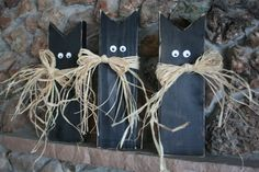 2x4 black cats. Easy to make... just cut a triangle out of the top to make ears. I've been making these with young children for years and they always turn out great!