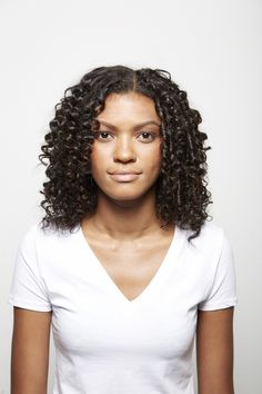Tamed and controlled curls on model Venessa after using Marula hair products