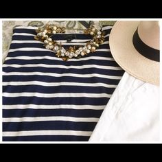 NWT, JCrew Striped T-Shirt With Pom-Poms  NWT, JCrew Striped T-Shirt w/Pom-Poms! Currently in season & sold out; What's better than stripes? Stripes + pom-poms! This lightweight drop-shoulder style is a twist on the classic nautical, the bottom is finished with tiny & adorable pom-poms all the way around! Presented in comfortable cotton with navy & natural stripes! So perfect with your white toothpick jeans or shorts.  Ready for summer fun!! J. Crew Tops Tees - Long Sleeve