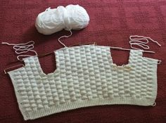 Faster way to knit a baby sweater. Great tutorial and picture..