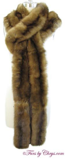 SOLD! Long Sable Stole #SS778; Excellent Condition; One Size Fits Most. This is a gorgeous genuine natural sable fur stole in a nice long length. This is a high quality piece, and it has plenty of silvery tips (one indication of high quality sable fur). It has an I. Magnin & Co. label and it is constructed of two rows of sable pelts with dark brown silk between each row. There is an opening at one end of the stole for different wearing options and there are no closures. Elegance…