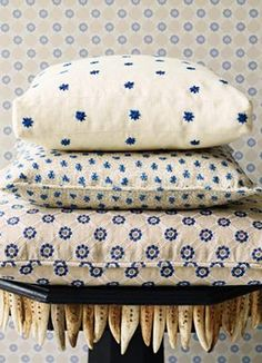Pillows in fabrics from Zoffany's Poesy Embroideries collection