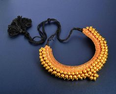 "Antique Indian High karat gold beads necklace 1 3/4"" on the widest part of the necklace tapered to 1 1/4"" Weight 120.4 dwt"