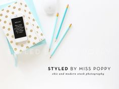 styled stock photo of a chic and stylish desktop adorned with beautiful gold and white polka dot notebook, turquoise pencils, Apple keypad and mouse as well as iPhone!