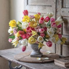 """Floral designer Sandra Sigman grounded her """"totally tulip"""" arrangement in a pedestal container, letting the various double, French, and lily-flowered forms of tulips express depth. Photography by Kindra Clineff Parrot Tulips, Purple Tulips, White Tulips, Tulips Flowers, Daffodils, Spring Flowers, Lilac, Growing Tulips, Planting Tulips"""