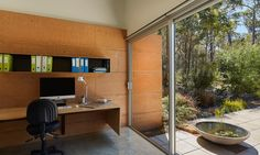 Two rammed earth walls and a concrete floor slab help retain thermal mass.