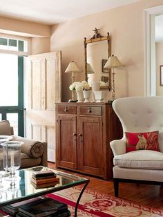 I love this soft foyer. The hutch serves as practical and pretty storage for a small space.