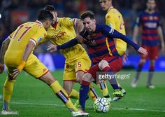 Barcelona's Argentinian forward Lionel Messi vies with Sporting Gijon's players during the Spanish league football match FC Barcelona vs Real...